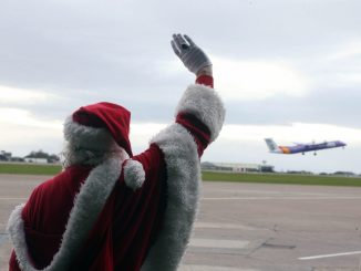 Santa waves passengers off at Cardiff Airport (Image: Cardiff Airport)