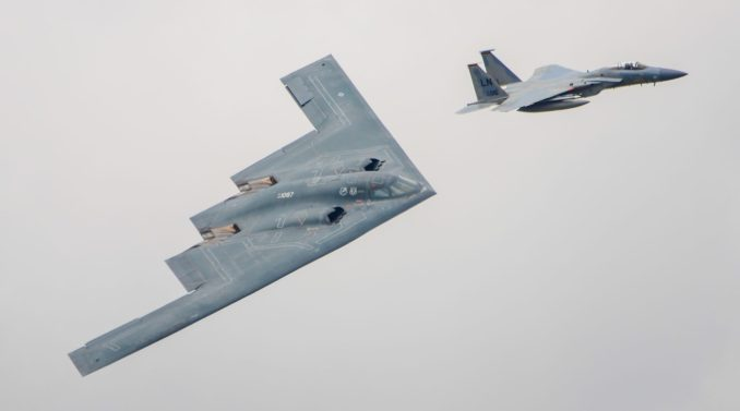 F15 escorting a B2 Stealth Bomber