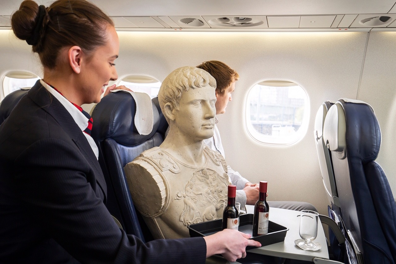 a bust of Ceaser on board British Airways first flight from London City to Rome