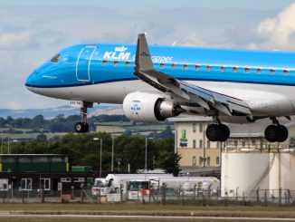 A KLM Embraer lands at Cardiff Airport (Image: TransportMedia UK)
