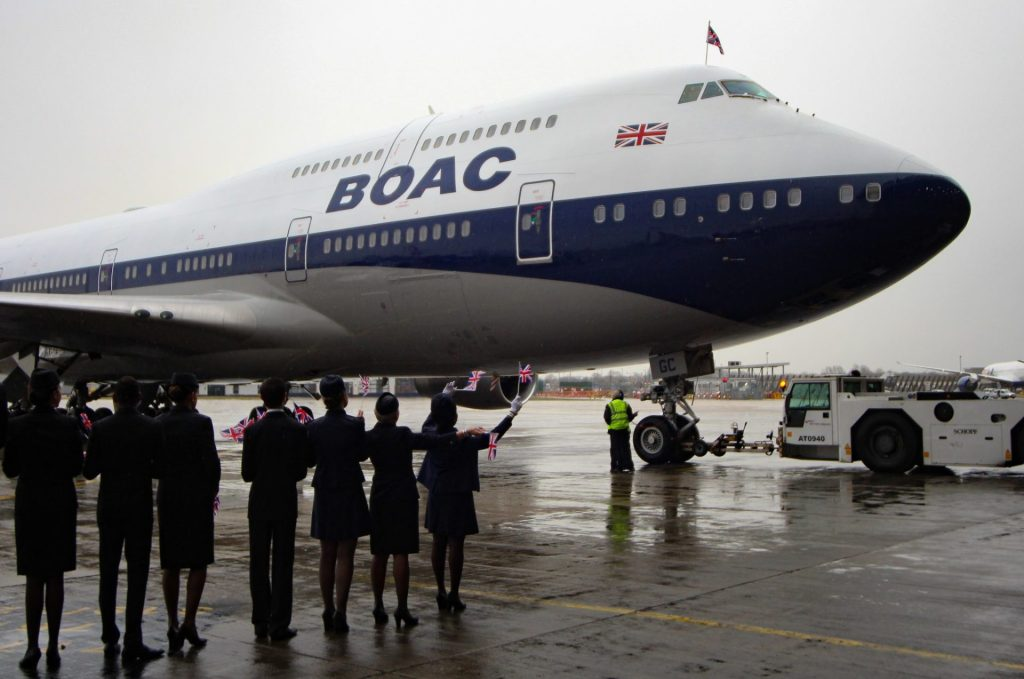 Cabin crew in period and modern uniforms greet BA100 (Image: Aviation Media Co.)