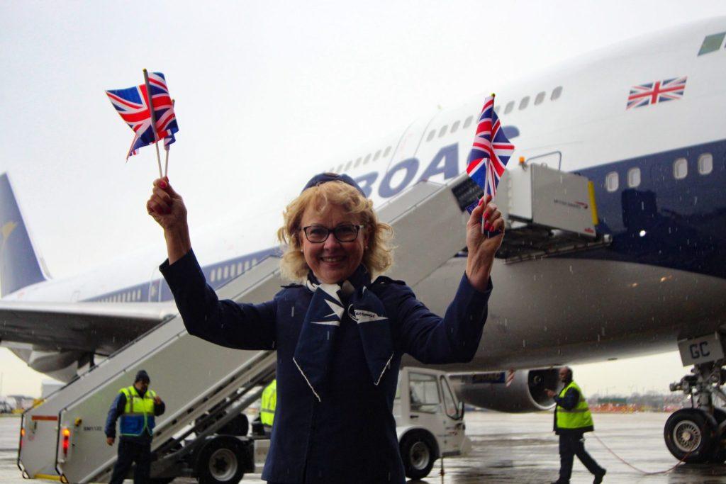 Not even rain could dampen the spirits of former BOAC crew member Linda Morrison (Image: Aviation Media Co.)