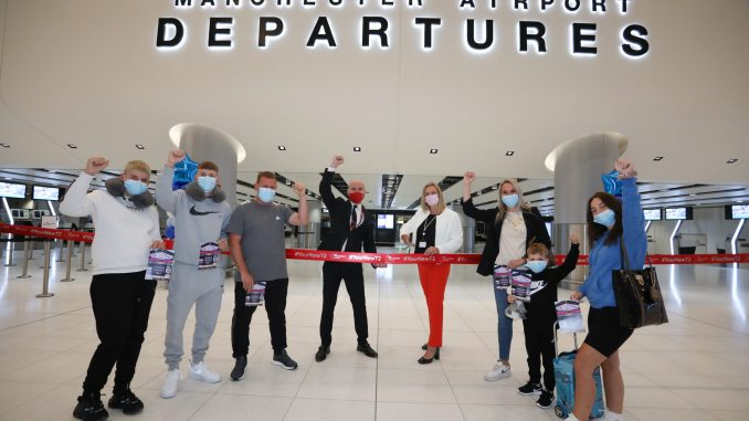 Marc Burns Jet2 and Karen Smart Manchester Airport with the Thompson family at Manchester Airports new Terminal Two