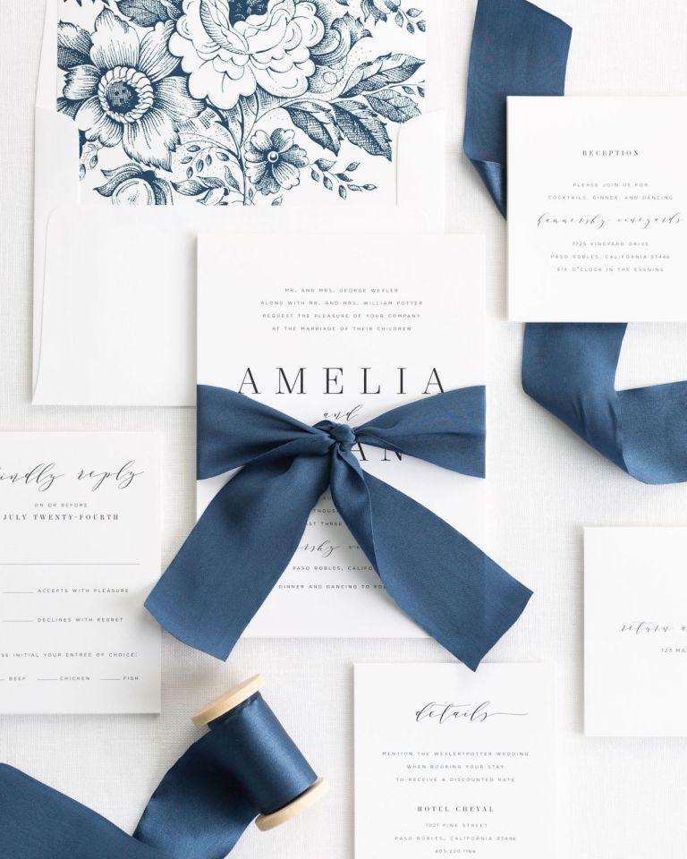 A beautiful blue navy ribbon tied by Shine Wedding Invitations.