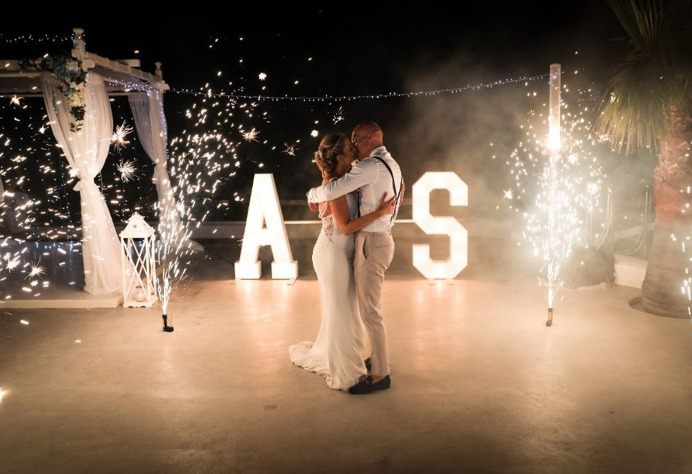 Sparkler shots are special but sparkler showers inside? That's impressive. Love this idea and a great shot by Daniel Burton Photography.