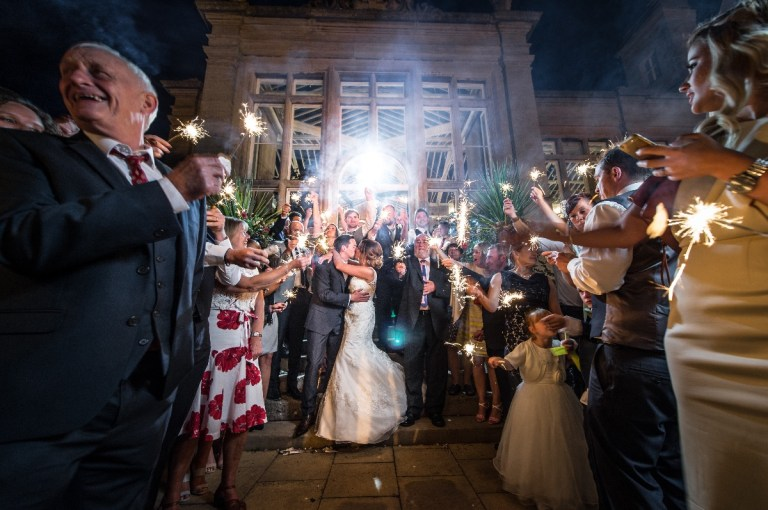 The photographers for this wedding was Dean Street Photography and they did an incredible job! We love the sparklers idea outside the gorgeous venue of Stoke Rochford Hall in Grantham.