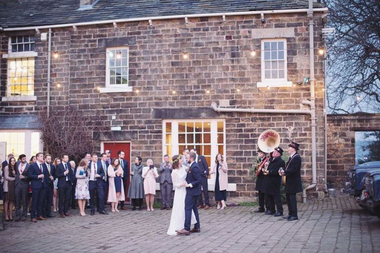 Their first dance was beautifully illuminated outside feature big band sounds.
