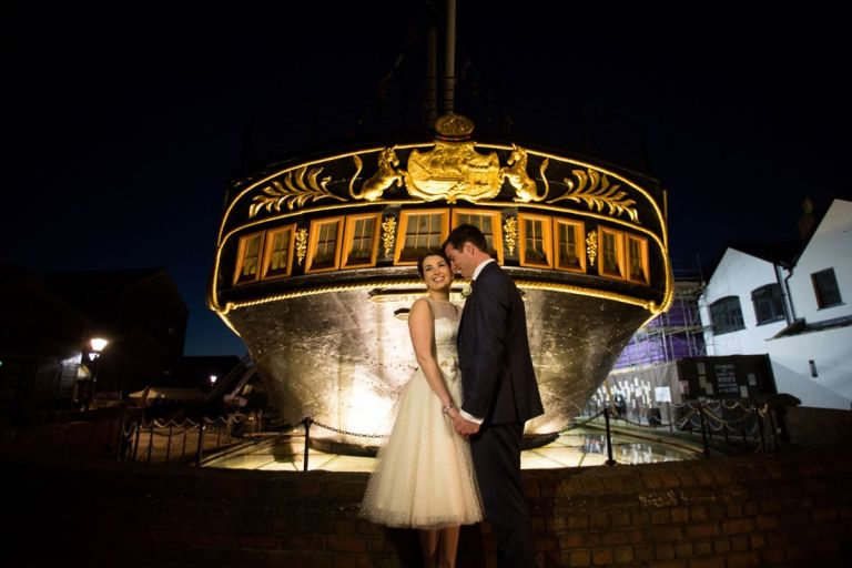 Have beautifully lit night time photos in front of the ship!