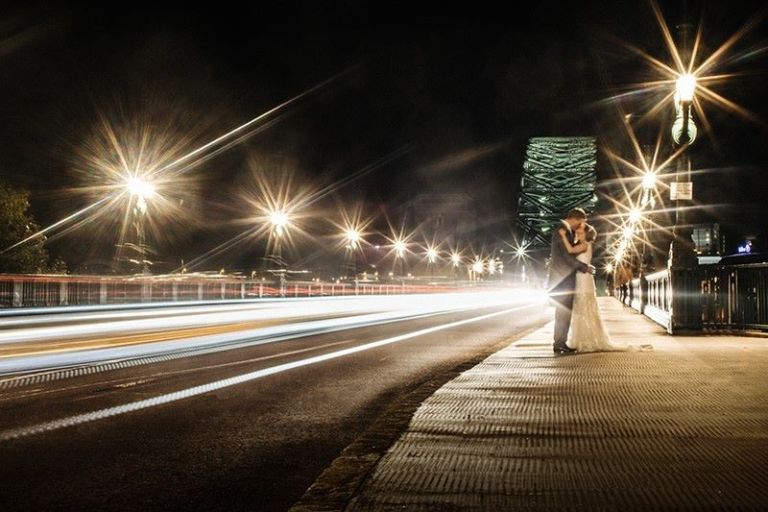The photographer used a slow shutter speed to make the car lights a blur and wonderfully capture the couple in front of Tyne Bridge.