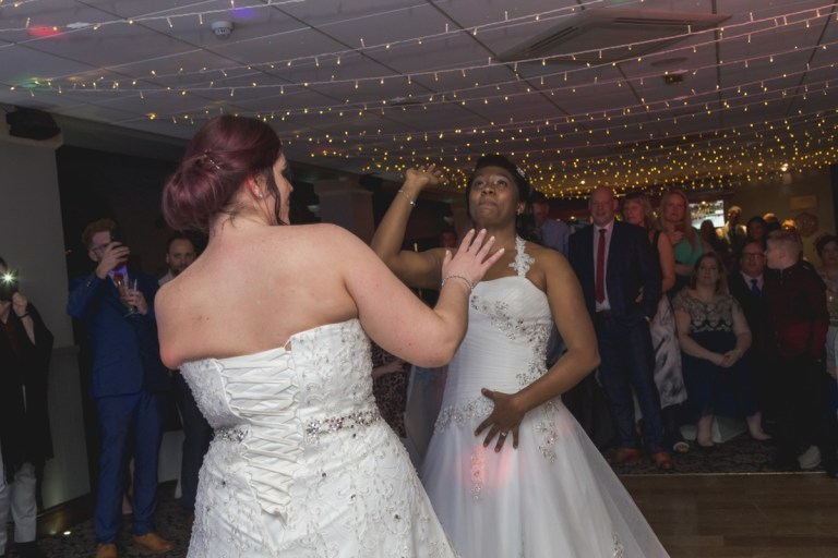 The happy couple throwing some shapes!