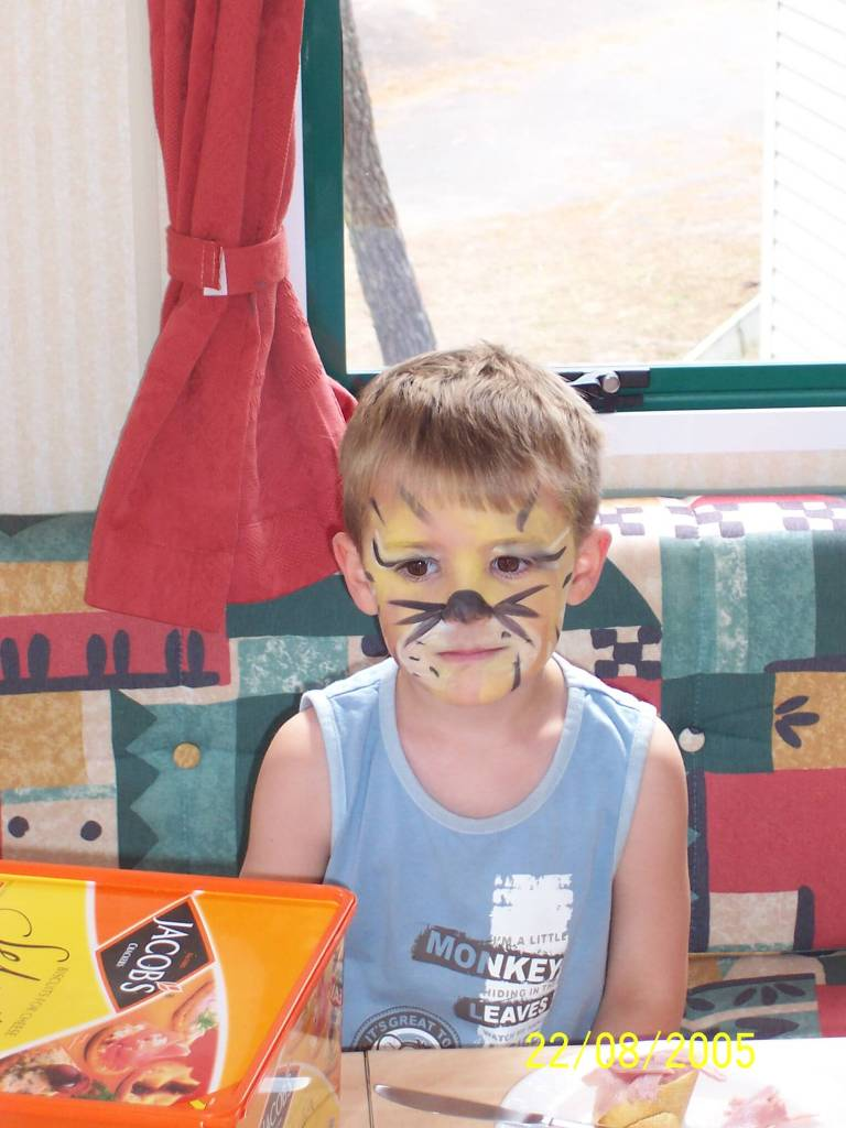 Bonne Anse Plage - boy with face painted