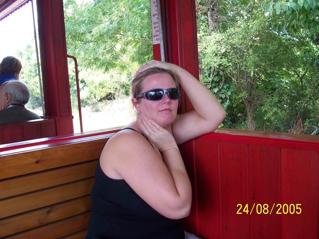 lady sat on a train