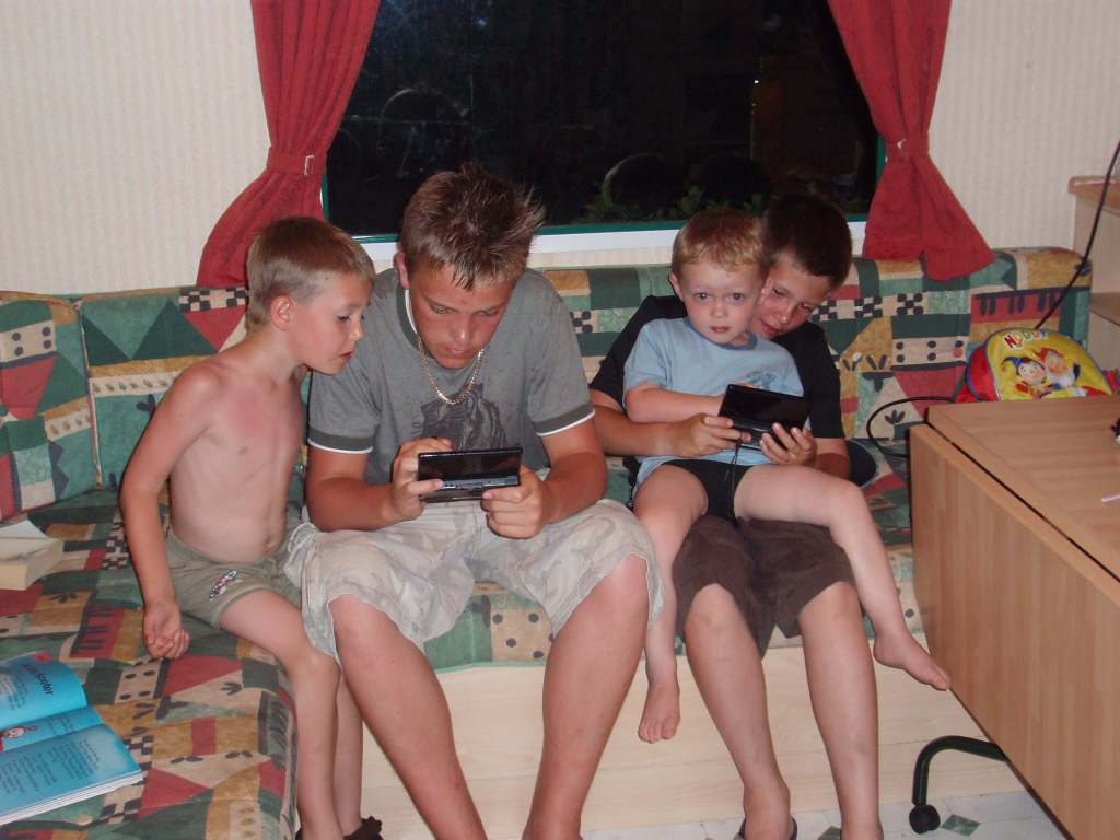 four boys playing games