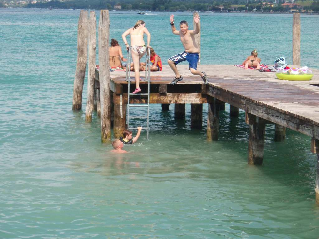 boy jumping into Lake Garda