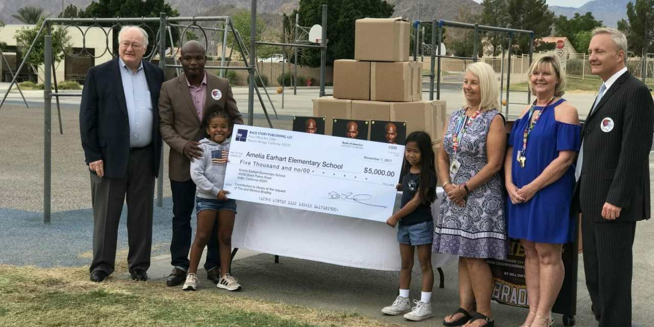 Tim Bradley Donates $5,000 for School Library