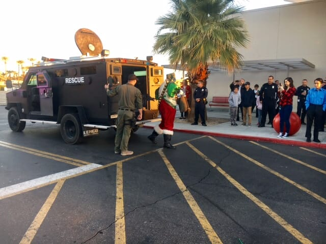 Shop with a Cop Attracts Dozens of Kids, Santa