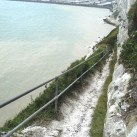 Path down to the beach, port in the background