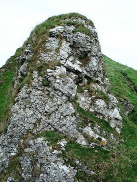 Rocky crag at the top of the hill