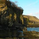 Tide receeds to reveal bedrock