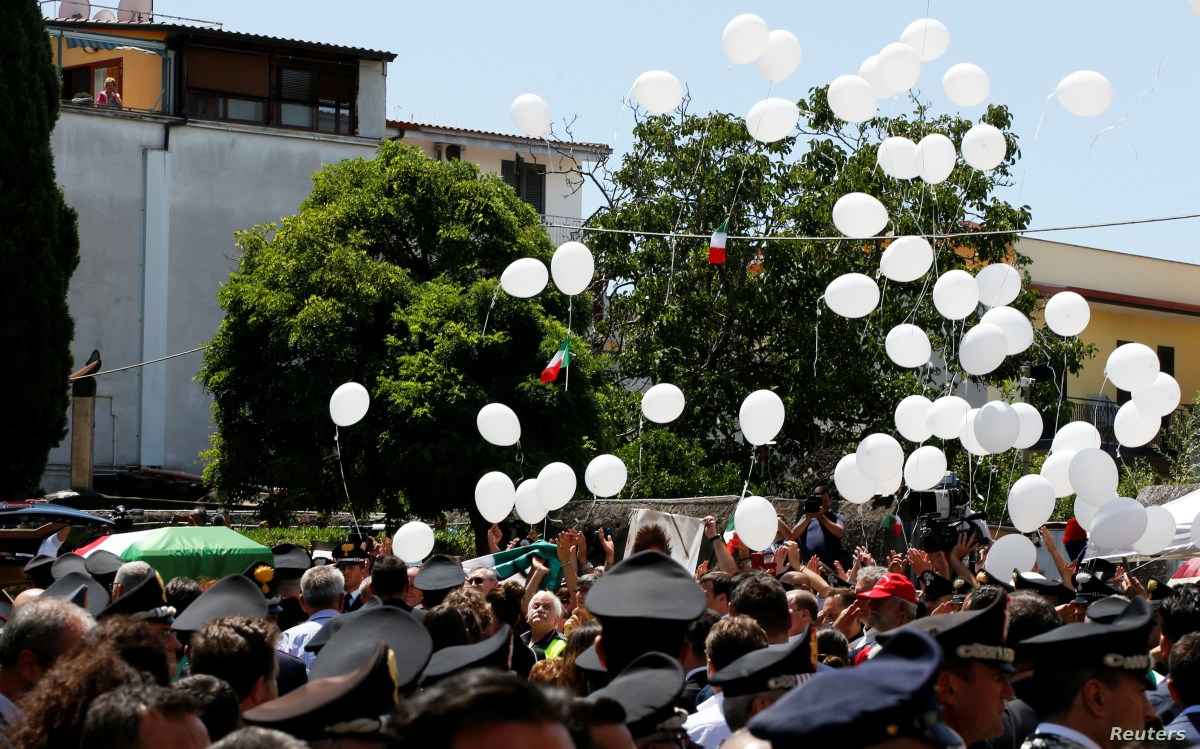 White balloons are released as the coffin of slain Carabinieri military police officer Mario Cerciello Rega is carried by Carabinieri officers outside the church of Santa Croce, during his funeral in his hometown Somma Vesuviana, Italy, July 29, 2019.