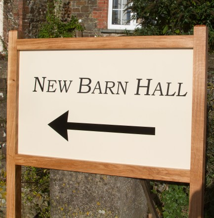 Oak posts and frame with aluminium composite sign. Strong and long lasting.