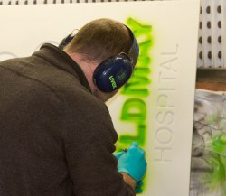 Spraying the letters with an airbrush