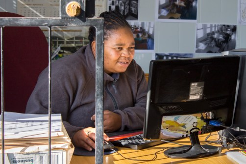 Landie Booi-Mngcambe works behind the computer at the Extension 9 Library, Grahamstown, on Wednesday, September 18, 2013. Landie often helps children to take out books that are appropriate for their age and reading abilities. (Photo: Sarah Kingon)