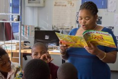 Landie Booi-Mngcambe reads a book to her reading group at the Extension 9 Library, Grahamstown, on Wednesday, September 18, 2013. Landie enjoys reading to the children and often translates some of the more difficult English phrases into isiXhosa to aid understanding. (Photo: Sarah Kingon)