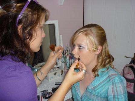 De-Anne Eggersglusz does Sarah Kingon's make up before the Clarendon High School Matric Dance in April 2010.
