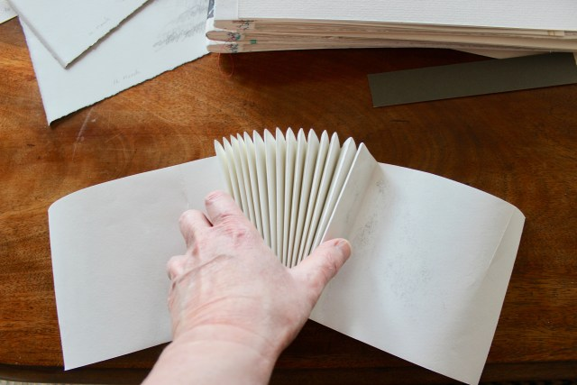 The spines are sewn by machine and then the sketches are sewn in by hand