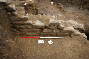 In places the north-south wall survived up to a height of eight courses of stonework (c.1m) above floor level.