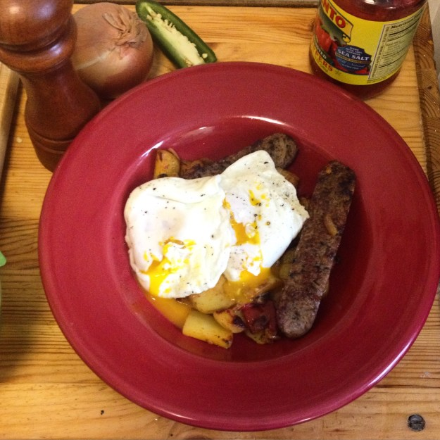 Eggs over easy with sausage