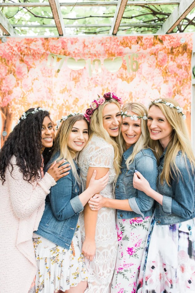 Garden bridal shower photo booth with the bride in a stunning lace bridal shower dress and a rose flower crown. A Roses and Mimosas Bridal Shower Brunch | Ultimate Bridesmaid | Alisha Maria Photography