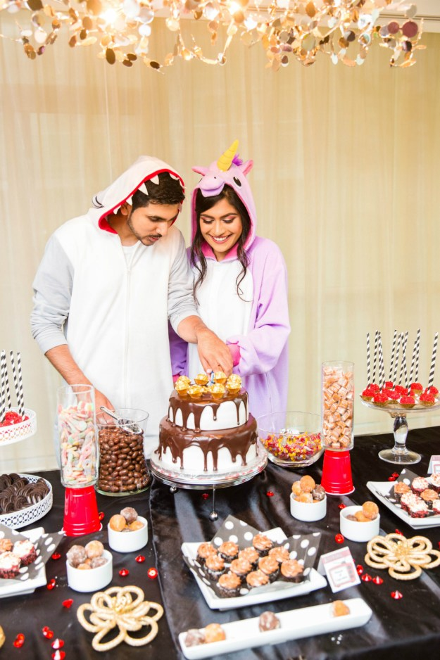 Everyone wore onesies and pajamas to this fun Netflix and Chill bridal shower, like the bride and groom seen here in a shark onesie and unicorn onesie. A Netflix and Chill Bridal Shower | Ultimate Bridesmaid | Photography by Azra