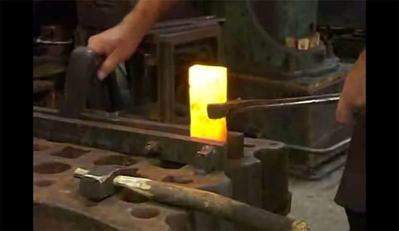 Hand Forging An Axe Using To Make A Log Cabin