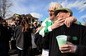 The annual Green Beer Day delivery at Coleman's kicks off the St. Patrick's Day season in Syracuse. Peter Coleman, of Coleman's Pub, poses for a photograph with Marty Barber, of Onondaga Beverage, who helped to pour the green beer from the truck as people lined up. (Michelle Gabel | mgabel@syracuse.com)