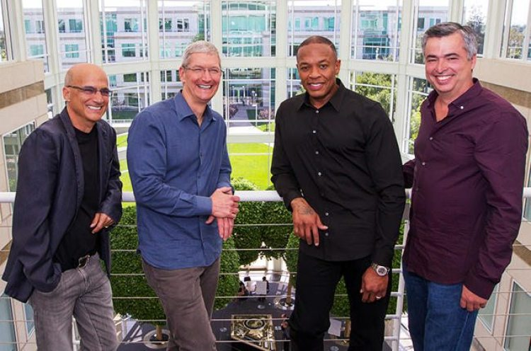 Jimmy Iovine (far left) with Apple CEO Tim Cook, Dr. Dre, and Apple VP Eddy cue. Photo from Billboard.