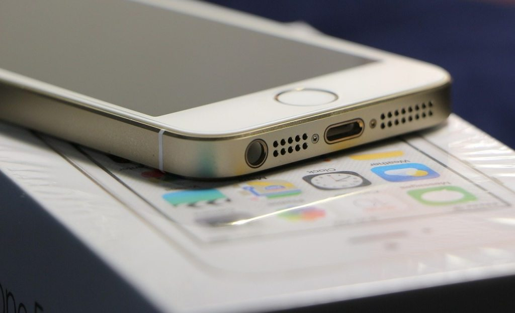 iPhone 5 and its audio jack and Lightning port.