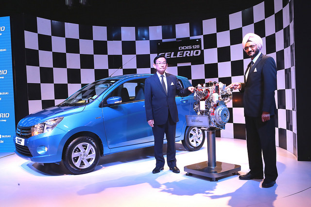 Kenichi Ayukawa, MD & R S Kalsi, ED M&S, Maruti Suzuki India pose next the the newly launched DDiS 125 diesel engine
