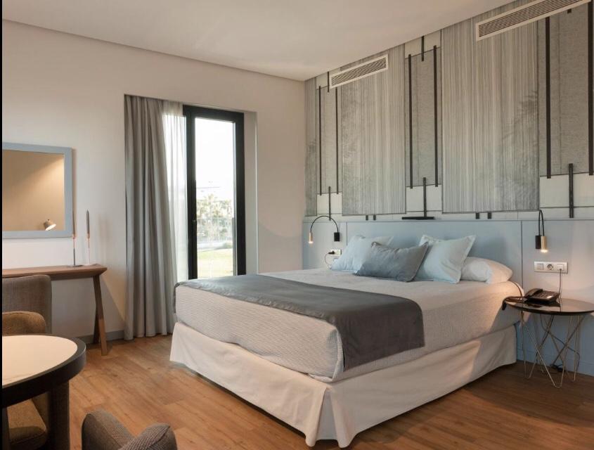 Quarto do Hotel Neptuno: conforto e proximidade à praia e El Cabanyal | Foto: Bookings