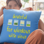 """Pillow that says """"Grateful for windows with a view."""""""