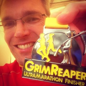 Giles with finishing medal for 2014 Grimreaper Ultramarathon