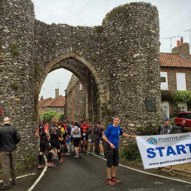 Start of Norfolk 100 under Castle Acre Bailey Gate