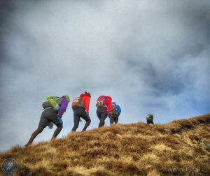 Climbing again under gathering clouds towards Dodd Fell (CP14)