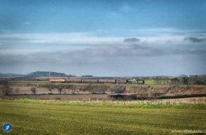 Steam train chugging along the railway