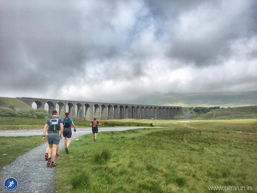 Through checkpoint 2 and approaching Ribblehead Viaduct, with our third peak Whernside hiding behind in the cloud