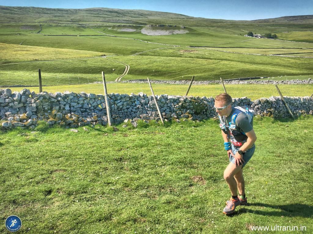 It's hot hot hot! Andrew climbing back towards Malham Tarn, with Fountains Fell now behind us.
