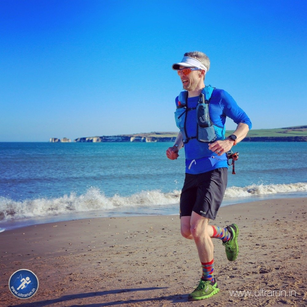 Giles Running Along Studland Bay Towards The Finish of The Jurassic Coast Challenge