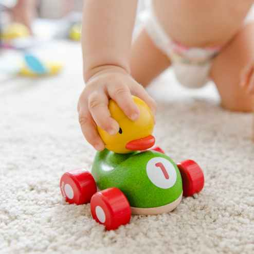 toddler playing duck toy