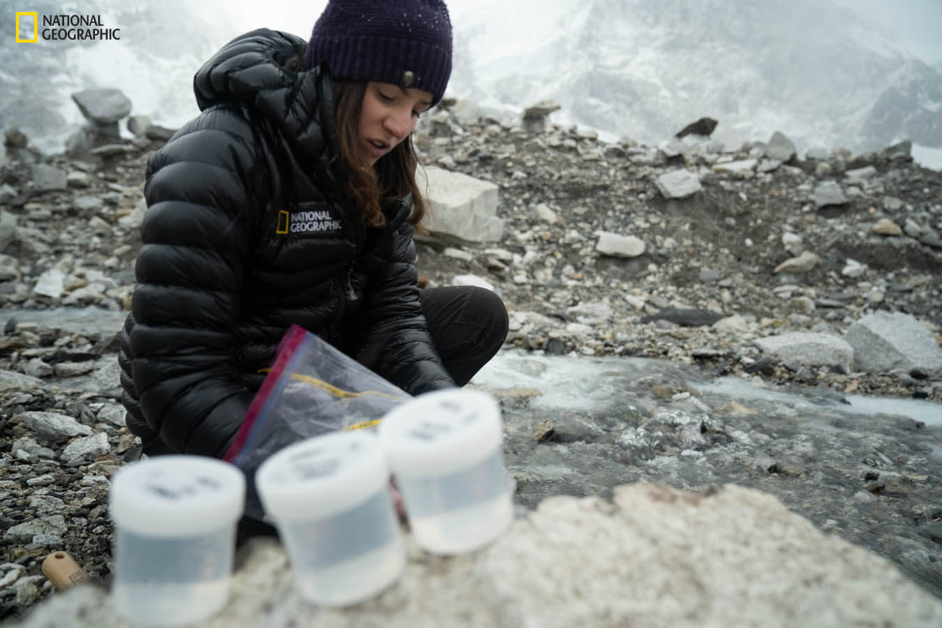 A woman collects samples near Mount Everest Base Camp.